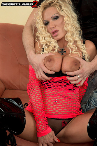 Sharon Pink – Big Boobed Blonde Bra buster In black spiked boots HD 720p